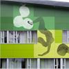 Mönstrade fasadskivor av stenkomposit, grön fasad