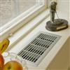 Kåbe litet konvektorgaller, vid ett fönster