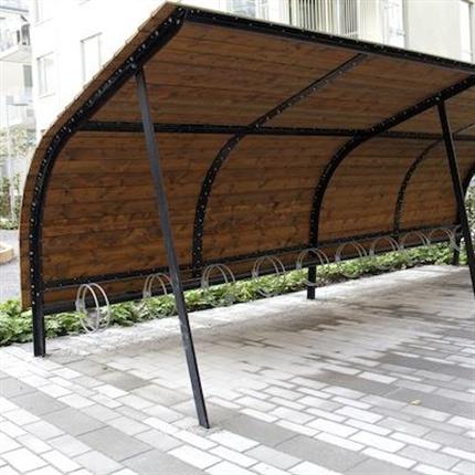 Revet är ett utbyggbart cykeltak i olika sektioner och längder. Taket är integrerat med Goggle hjulhållare och ger praktisk förvaring av cyklar. Taket är utformat med svarta stålstativ och en välvd takform i linaximpregnerad furu.