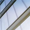 Semitransparant fasadsystem, isolerande paneler
