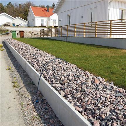 Lindborgs Ankarbalken grundbalk som L-stöd på tomt