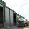 Ekonomisk metallport för stora öppningar, vertikaltgående rullport av isolerad stålplåt, för industribruk