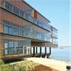 inglasade balkonger vid vatten, balkonginglasning, ramlösa balkonger, harmoniskt uterum