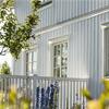 Sjävlrengörande fasadfärg, oljefärg på vitt hus