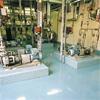 Tunnskiktsbeläggning i industrihall