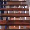 Trappa med två underliggande vangstycken, nåtade steg i mahogny