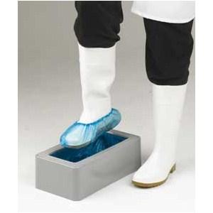 Foten i lådan och skoskyddet är på